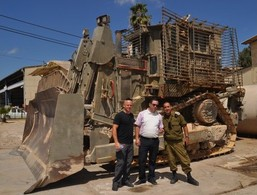 Alan Schall and Rabbi Sam Klibanoff of Congregation Etz Chaim of New Jersey posing with a commanding officer in front of a D9 IDF Armored Combat Bulldozer. Many thanks to Congregation Etz Chaim for raising over $70,000 to make this mission possible!!!