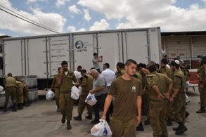 This huge truck delivered over 2000 care packages to soldiers on various bases in the south. This base services all sorts of IDF equipment, lasers, optics, tractors and machinery.