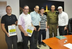 Receiving a certificate of recognition from the commanding officer. From left to right: Alan Schall, Rabbi Klibanoff, Morris/ Moshe Smith, Geoffrey Rochwarger of Beit Shemesh, IDF commander, Yossi Kaufman. Great job guys!!!