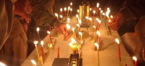 soldiers light candles